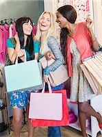 Women carrying shopping bags in clothing store Stock Photo - Premium Royalty-Freenull, Code: 6113-07791123