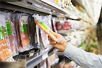 Man selecting product in grocery store Stock Photo - Premium Royalty-Freenull, Code: 6113-07791217