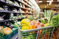 Close up of full shopping cart in grocery store Stock Photo - Premium Royalty-Freenull, Code: 6113-07791219