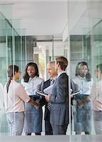 Business people talking in office building Stock Photo - Premium Royalty-Freenull, Code: 6113-07791285