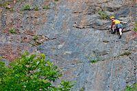 rock climber - Female climber, leading