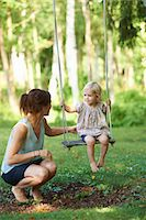 swing (sports) - Mid adult mother and toddler daughter playing on garden swing Stock Photo - Premium Royalty-Freenull, Code: 649-07804290