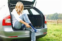 female rear end - Woman sitting at rear of car putting on socks Stock Photo - Premium Royalty-Freenull, Code: 649-07804578