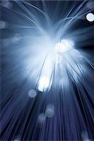 pattern (man made design) - Close up of illuminated fiber optic light exploding outwards Stock Photo - Premium Royalty-Freenull, Code: 649-07804814