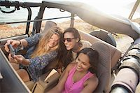 Three young women taking selfie on smartphone in jeep at coast, Malibu, California, USA Stock Photo - Premium Royalty-Freenull, Code: 614-07805820