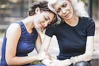Young woman sharing tender moment with mentor Stock Photo - Premium Royalty-Freenull, Code: 614-07806438