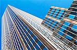 Low angled view of office buildings in financial district, Manhattan, New York, USA