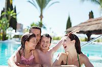 Family with two children enjoying themselves in swimming pool Stock Photo - Premium Royalty-Freenull, Code: 6113-07808104