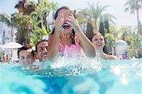 Family with two children enjoying themselves in swimming pool Stock Photo - Premium Royalty-Freenull, Code: 6113-07808114