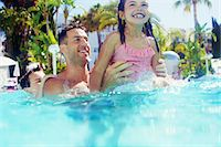 preteen swimsuit - Father with daughter and son playing in swimming pool Stock Photo - Premium Royalty-Freenull, Code: 6113-07808139