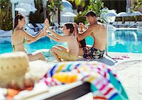 Family with two children enjoying themselves by swimming pool Stock Photo - Premium Royalty-Freenull, Code: 6113-07808157