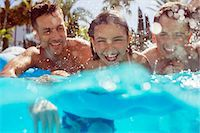 Father swimming with his two children in swimming pool Stock Photo - Premium Royalty-Freenull, Code: 6113-07808162
