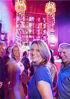 Happy mature people having fun in nightclub Stock Photo - Premium Royalty-Freenull, Code: 6113-07808592