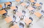 Elevated view of rows of desks and chairs in empty classroom