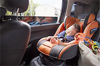 A mother and her young baby boy in a car. Stock Photo - Premium Royalty-Freenull, Code: 6118-07808991