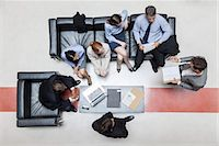 Executives in meeting, overhead view Stock Photo - Premium Royalty-Freenull, Code: 632-07809423
