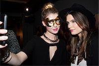 Women taking selfie at party Stock Photo - Premium Royalty-Freenull, Code: 632-07809430