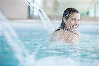 swimming pool water - Woman relaxing under fountain in swimming pool Stock Photo - Premium Royalty-Freenull, Code: 632-07809529