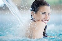 swimming pool water - Woman relaxing under fountain in swimming pool Stock Photo - Premium Royalty-Freenull, Code: 632-07809530