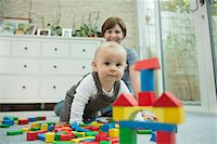 Mother and her little son with building bricks Stock Photo - Premium Royalty-Freenull, Code: 6121-07809784