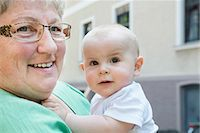 Grandmother holding little grandson Stock Photo - Premium Royalty-Freenull, Code: 6121-07809838