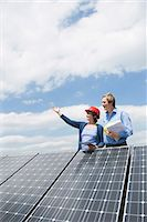 Female engineer client solar roof panel energy Stock Photo - Premium Royalty-Freenull, Code: 6121-07810071