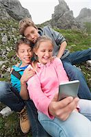 Girl and teenage boys self-portrait cell phone Stock Photo - Premium Royalty-Freenull, Code: 6121-07810260