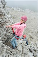 Brother sister climbing rock face mountains rope Stock Photo - Premium Royalty-Freenull, Code: 6121-07810287