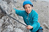 Young teenage boy helmet rope climbing safety Stock Photo - Premium Royalty-Freenull, Code: 6121-07810289
