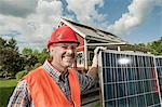 Portrait workman helmet smiling solar panel