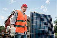 solar power - Close up portrait man holding solar panel Stock Photo - Premium Royalty-Freenull, Code: 6121-07810428