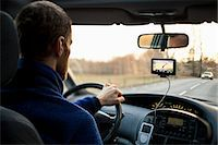 Rear view of man driving car while using GPS Stock Photo - Premium Royalty-Freenull, Code: 698-07813046