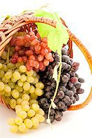 three varieties of grapes in a basket isolated on white background Stock Photo - Royalty-Freenull, Code: 400-07817181