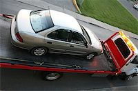Car on a flatbed with grill and towed by red truck Stock Photo - Royalty-Freenull, Code: 400-07819763