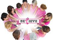 Cheerful women joined in a circle wearing pink for breast cancer against breast cancer awareness message Stock Photo - Royalty-Freenull, Code: 400-07835053