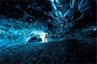 Interior of Ice Cave with Mountain Guide, Iceland Stock Photo - Premium Rights-Managednull, Code: 700-07840748