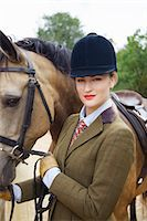 equestrian - Woman in Riding Outfit with Horse Stock Photo - Premium Rights-Managednull, Code: 822-07840876