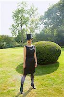 riding crop - Young Woman in Top Hat and Veil Holding Riding Crop in Garden Stock Photo - Premium Rights-Managednull, Code: 822-07840886