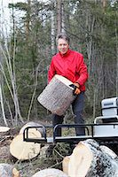 Man transporting cutted trunks Stock Photo - Premium Royalty-Freenull, Code: 6102-07842695