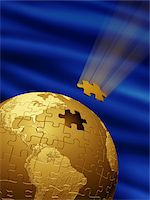 Golden globe made of puzzle pieces with blue background Stock Photo - Premium Rights-Managednull, Code: 700-07844406