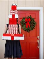 Woman with stack of gifts Stock Photo - Premium Royalty-Freenull, Code: 613-07845262