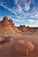extreme terrain - Sandstone formations with clouds, Coyote Buttes Wilderness, Vermilion Cliffs National Monument, Arizona, United States of America, North America Stock Photo - Premium Royalty-Freenull, Code: 6119-07845624