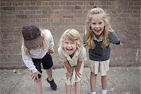 school girl uniforms - Public school children in playground Stock Photo - Premium Royalty-Freenull, Code: 613-07849341