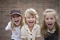 school girl uniforms - Friends at school in playground Stock Photo - Premium Royalty-Freenull, Code: 613-07849350