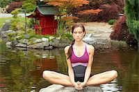 A sensual woman performs Yoga on a Rock Stock Photo - Royalty-Freenull, Code: 400-07892238