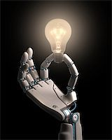 Robot hand holding a bulb on a conceptual idea technology. Clipping path included. Stock Photo - Royalty-Freenull, Code: 400-07894358