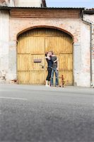 Couple kissing in front of building entrance on street, Suno, Novara, Italy Stock Photo - Premium Royalty-Freenull, Code: 649-07904980