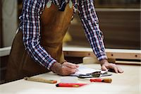 Cropped shot of mature craftsman making notes in organ workshop Stock Photo - Premium Royalty-Freenull, Code: 649-07905049