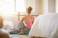 flexible (people or objects with physical bendability) - Mid adult woman practicing yoga on bedroom floor Stock Photo - Premium Royalty-Freenull, Code: 649-07905162