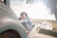 pushing - Woman pushing broken down car Stock Photo - Premium Royalty-Freenull, Code: 649-07905217